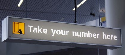 take a number sign